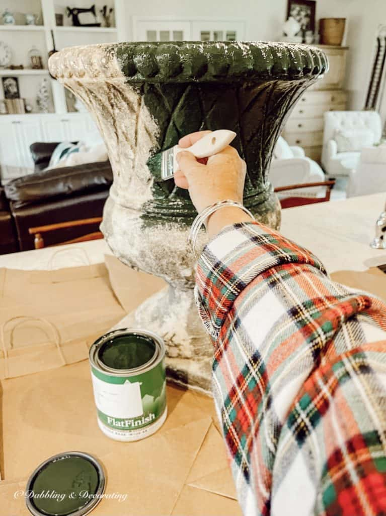 Painting urn green.