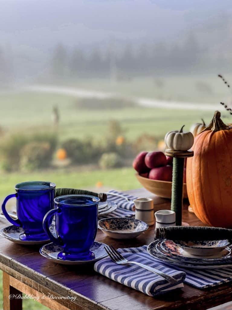 blue mugs on table foggy morning.